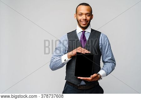 Young Handsome African-american Businessman Holding Tablet Pc