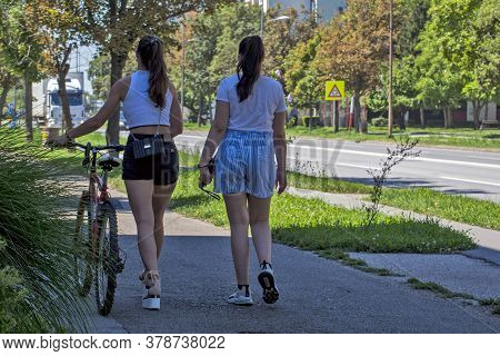 Two Girls And A Bicycle
