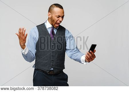 African-american Business Man Talking On Mobile Phone - Stress And Negativity