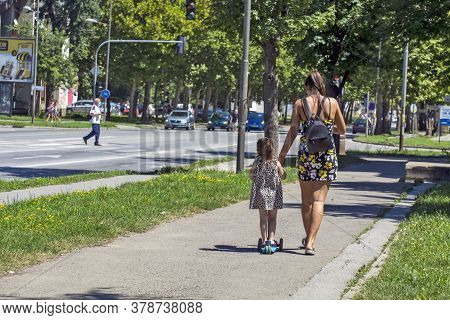 Mom And Little Girl On The Street