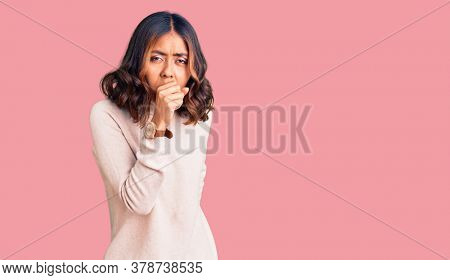 Young beautiful mixed race woman wearing winter turtleneck sweater feeling unwell and coughing as symptom for cold or bronchitis. health care concept.