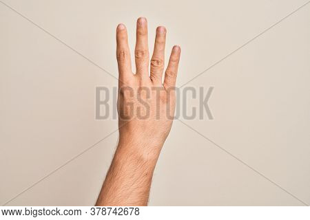 Hand of caucasian young man showing fingers over isolated white background counting number 4 showing four fingers
