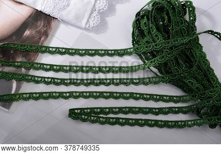 Tapes Of Green Gentle Guipure, Beauty Lace Fabric On Light Background. Elastic Material. Using For A