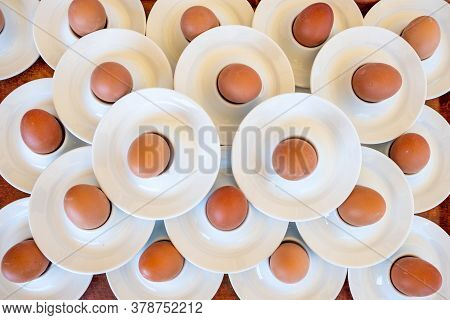 Boiled Eggs Served From White Egg Cups