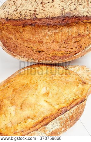 Two Loaves Of Fresh Bread. Crusty Bread Loaves Isolated On White Background.
