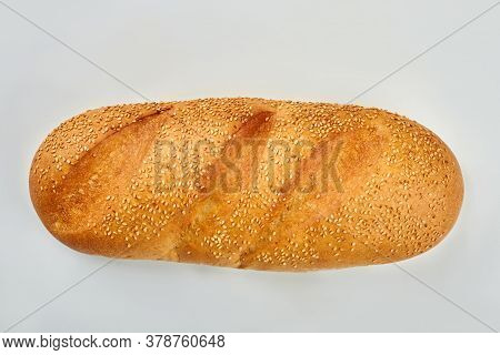 Sesame Seeds On French Bread. Loaf Of French Bread Isolated On White Background. Delicious Food For