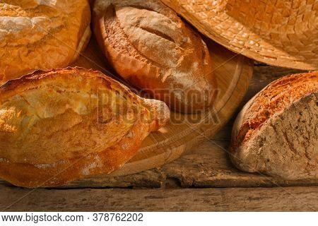 Fresh Bakery Products Background. Crusty Artisan Bread. Healthy Food Concept.
