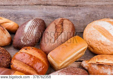 Various Types Of Bread On Wooden Background. Healthy Organic Bread.