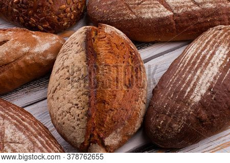 Crusty Fresh Bread On Wooden Background. Homemade Brown Bread Loaves.
