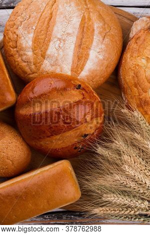 Healthy Artisan Bread And Wheat Ears. Bread And Bakery Products Background, Top View.