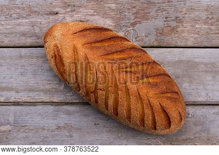 Rustic French Bread On Wooden Background. Artisan French Bread On Old Wooden Boards.