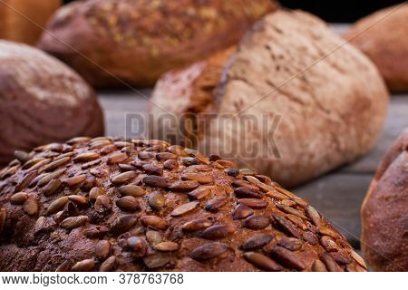 Close Up Of Artisan Bread With Pumpkin Seeds. Whole Grain Bread Close Up. Healthy Food.