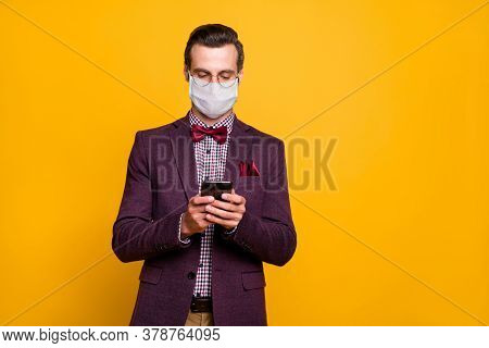 Portrait Of His He Focused Imposing Guy Wearing Safety Mask Using Gadget Browse News Flu Grippe Resp