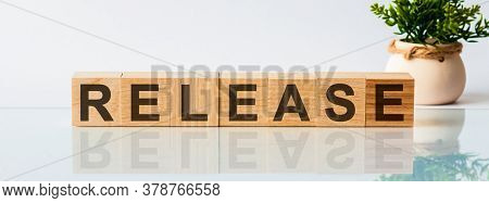 Release Message Word On A Wooden Desk On Cube Blocks With A Flower On Background