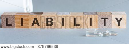 Wooden Blocks With The Text: Liability. The Text Is Written In Black Letters. Medical Concept.