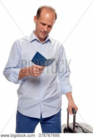 Portrait Of Young Man Tourist Holding Passport And Traveling With Visa-free Regime