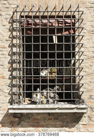 Ravenna, Italy.  July 28, 2020.  Cats Sculptures Locked Up In Jail