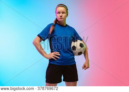 Confident Posing. Female Soccer, Football Player Training In Action Isolated On Gradient Studio Back