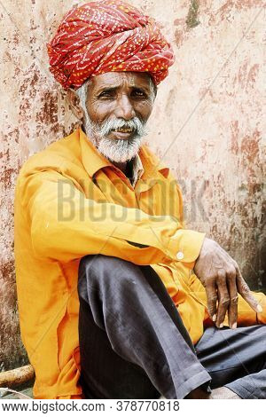 Portrait of old poor man in tradtional clothing and turban. Jaisalmer town. feb 2013. Rajastan, India