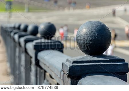 Metal Balls Painted With Gray Paint On The Railing Of The Bridge.