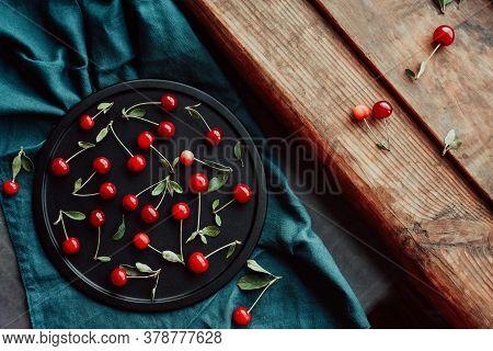 Ripe Cherries On A Black Dish. Cottagecore Aesthetics. Rustic, Vintage Style Harvest Season Concept