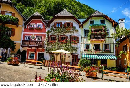 Hallstatt, Austria. Scenic postcard view of historic village town square. Traditional colorful houses at Hallstatter See in Austrian Alps. Salzkammergut region. Flowers in pots and old architecture.