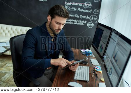 Business Analysis. Young Focused Businessman, Financial Analyst Or Sales Manager Sitting At His Work