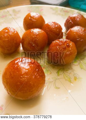 Gulab Jamun Balls With Sugar Syrup Placed In A White Plate.they Are Made Of Bread While Homemade.the