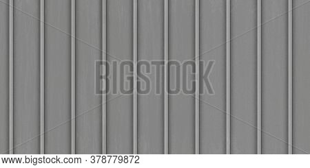 Gray Corrugated Metal Texture. Crimp Fence Background. Ribbed Metallic Surface. Wavy Iron Wall Patte