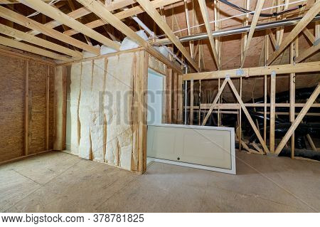 Wooden Roof Beams With Insulates The Attic With Mineral Wool And Pipe Heating System