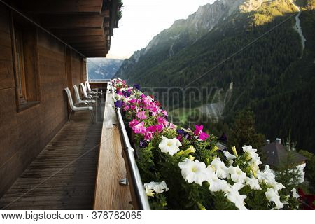 Terrace Of Classic Vintage Retro Wooden Building Resort For Austrian People Living And Foreign Trave