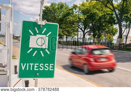 French-language  Sign Warning Of Photo Radar Speed Camera In Montreal, Canada - Vitesse Means Speed