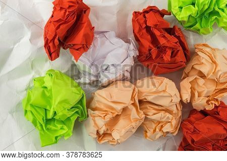 View From Above On The Colored Dense Crumpled Paper, Which Lies On The White Slightly Crumpled Paper
