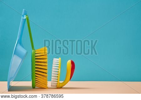 Cleanup. Sweeping. Cleaning Supplies. Brush With Handle And Trowel Isolated On Blue Background. Copy