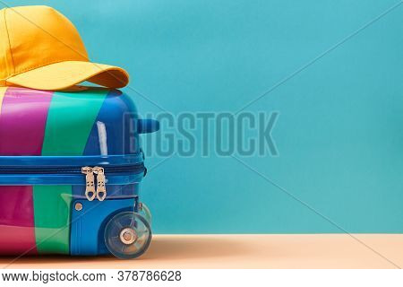 Time To Travel. Summer Vacation. Travelling Abroad. Summer Holidays. Colourful Suitcase And Cap On T