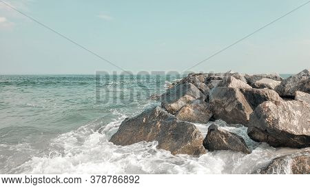 Seascape Of Rocky Beach. Sea Waves Crash And Splash On Rocks. View Of The Sea, Ocean. Natural Soft B
