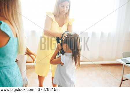 Mom Puts On Her Child A Gas Mask, Gas Attack Exercises, Child Education.