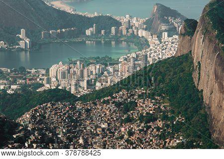 Biggest Brazilian Favela Rocinha On The Hill And Leblon Neighborhood Behind, Contrast Between Rich A