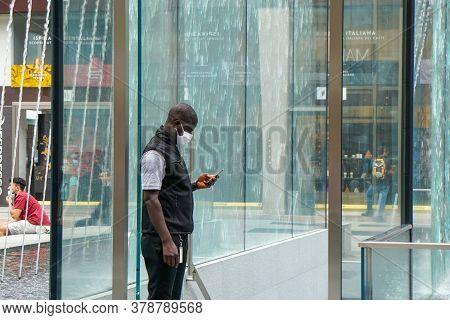 Milan - 6/17/2020 : Security Guardian Controls His Phone