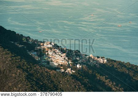 Brazilian Favela On The Hill With Beautiful Ocean View In Rio De Janeiro