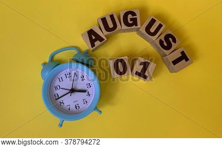 August 1.august 1 On Wooden Cubes On A Yellow Background.photos For The Holiday .the Last Month Of S
