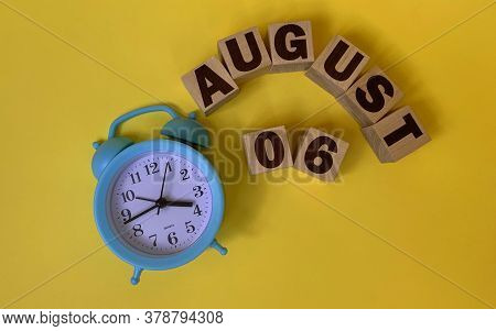 August 6.august 6 On Wooden Cubes On A Yellow Background.photos For The Holiday .the Last Month Of S