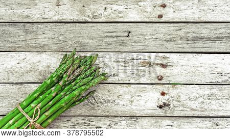 Bunch Of Fresh Asparagus On Wooden Background. Green Raw Sprouts Of Asparagus Officinalis. Spring Ve