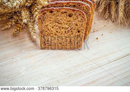 Traditional Bread. Fresh Loaf Of Rustic Traditional Bread With Wheat Grain Ear Or Spike Plant On Woo