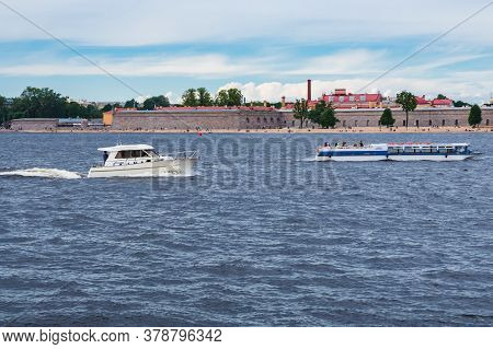Pleasure Crafts In The Waters Of The Neva River On The Traverse Of The Peter And Paul Fortress On Cl