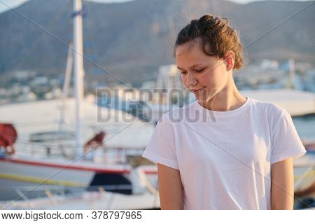 Portrait Of Teenage Girl 15 Years Old, Happy Smiling Teenager, Summer Sunset Sea Harbor With Yachts