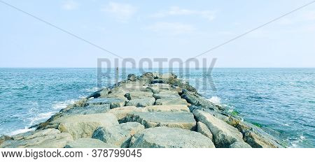 Seascape Of Waves Breaking On Rocky Beach. Sea Waves Crash And Splash On Rocks. View Of The Sea, Oce