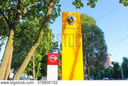 Kyiv, Ukraine - July 29, 2020: Renault And Nissan Dealership Signs Against Blue Sky. Renault Is Know