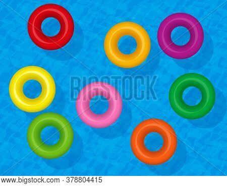 Swim Rings, Colorful Inflatable Water Tubes, Colored Lifesavers. Set Of Floating Plastic Donuts On B