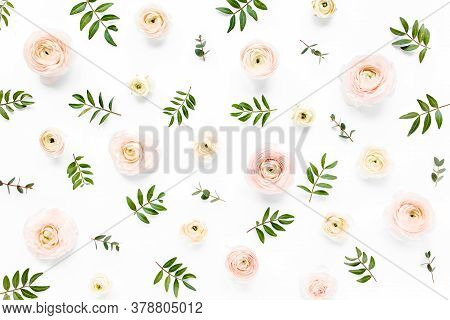 Floral Background Texture Made Of Pink Ranunculus Flower Buds And Eucalyptus Branches On White Backg